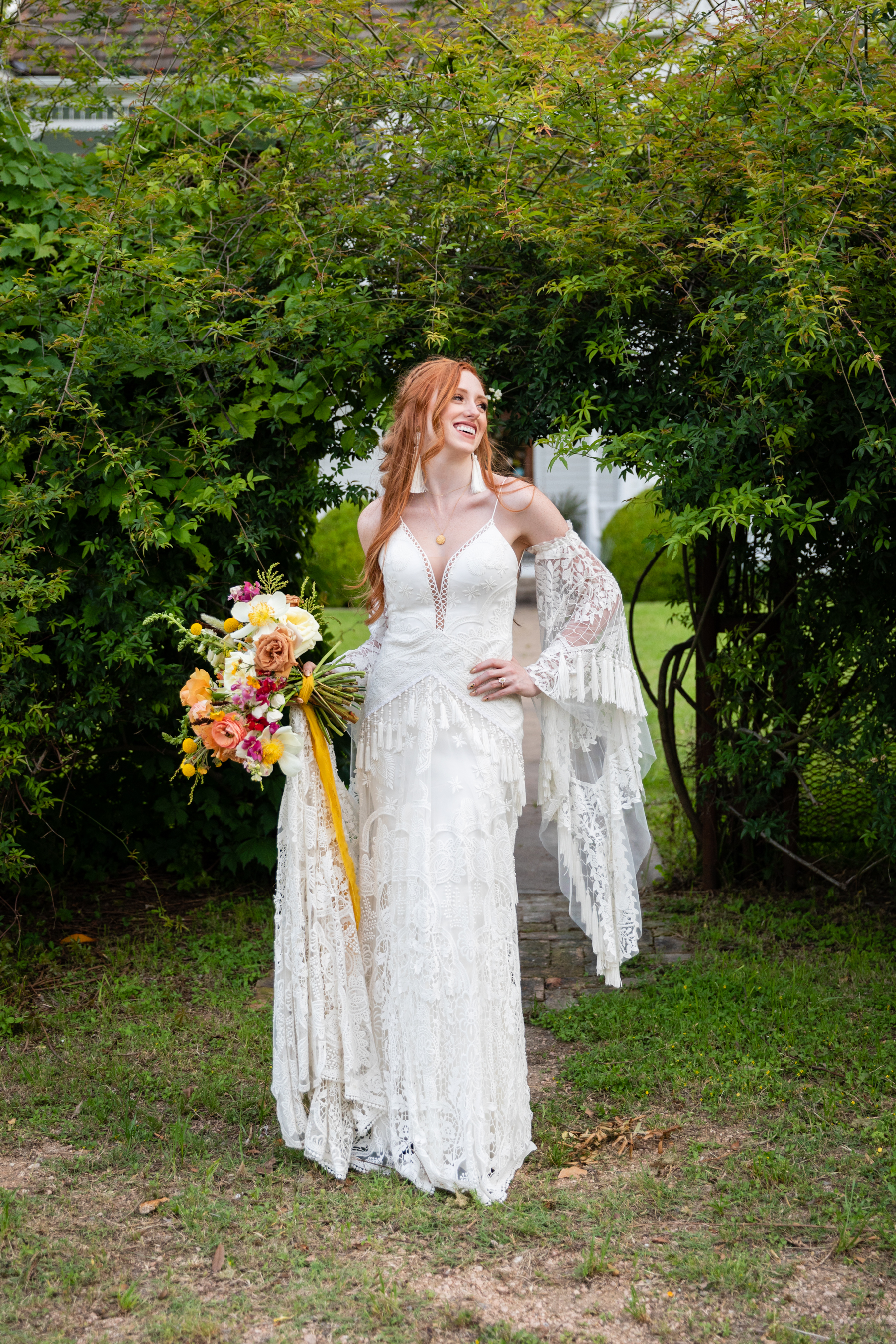 Jalyn wore a gown by Rue de Seine for her boho Austin, TX wedding
