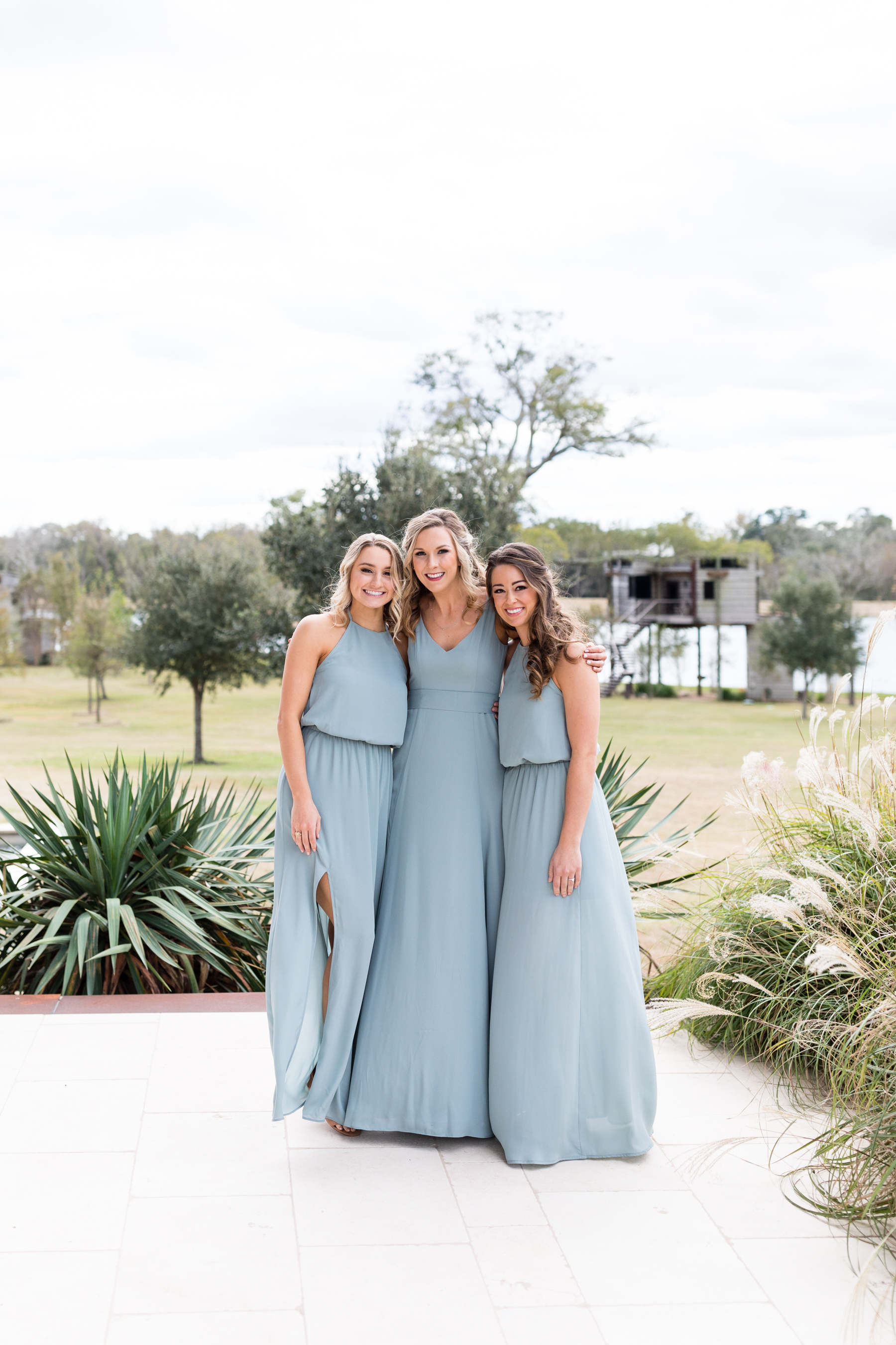 bridesmaids enjoying the outdoor space at a Texas ranch wedding