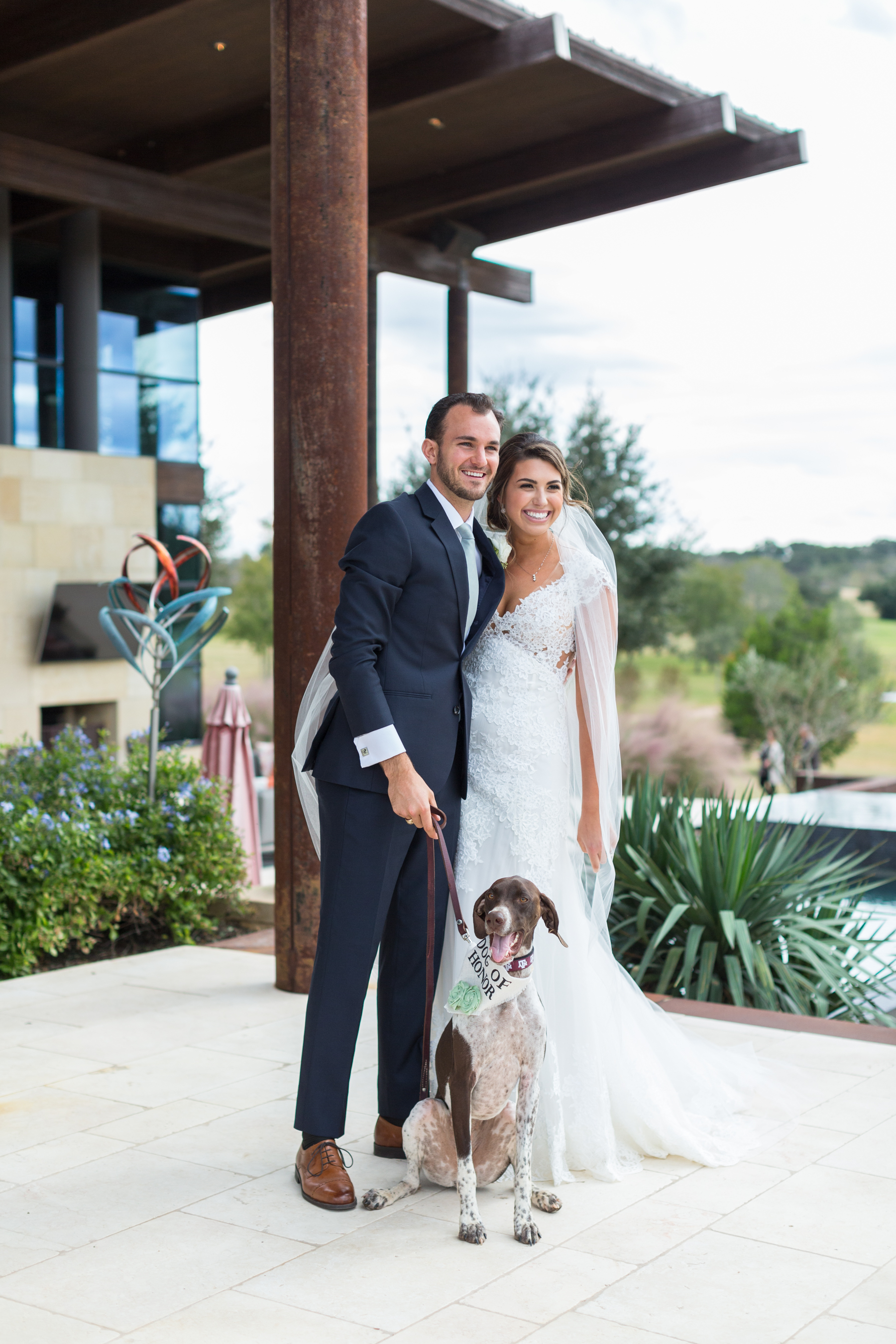 bride and groom with their dog in wedding day in Texas